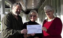 The friends receiving a cheque for £1700