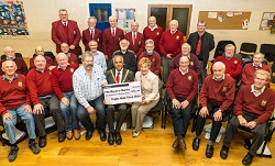 Choir members present the cheque to the Mayor, Councillor Ramesh Srivistava, accompanied by Willy Goldschmidt and Kathryn Lawrence.