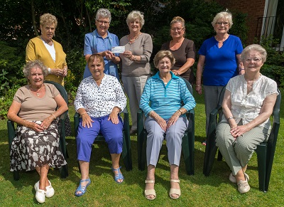 Ladies of Hannover Court present a cheque to Chrsyanda Gilbert