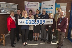 Representatives of the Coventry present the donation placard to trustees of the Friends of St Cross and the General Manager of the hospital.